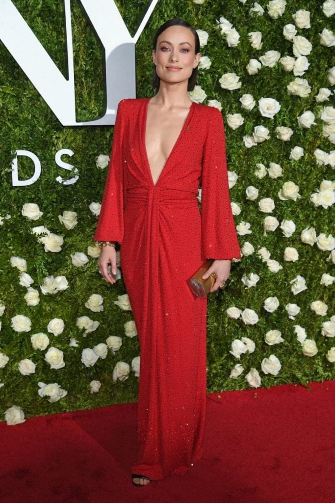 Beautifully draped red, soft flowing look, tapered at the waist