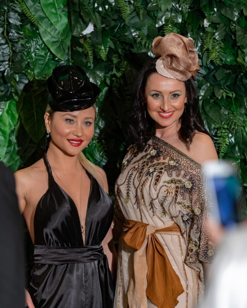 Cindy Carino and Yana Duckta both wearing Lucy Laurita and Stevens Hats