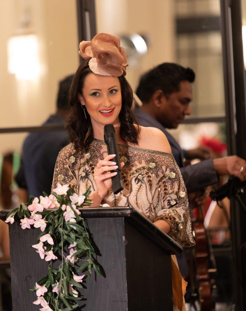 Event MC Yana Dukta wearing Lucy Laurita dress and Steven Hats