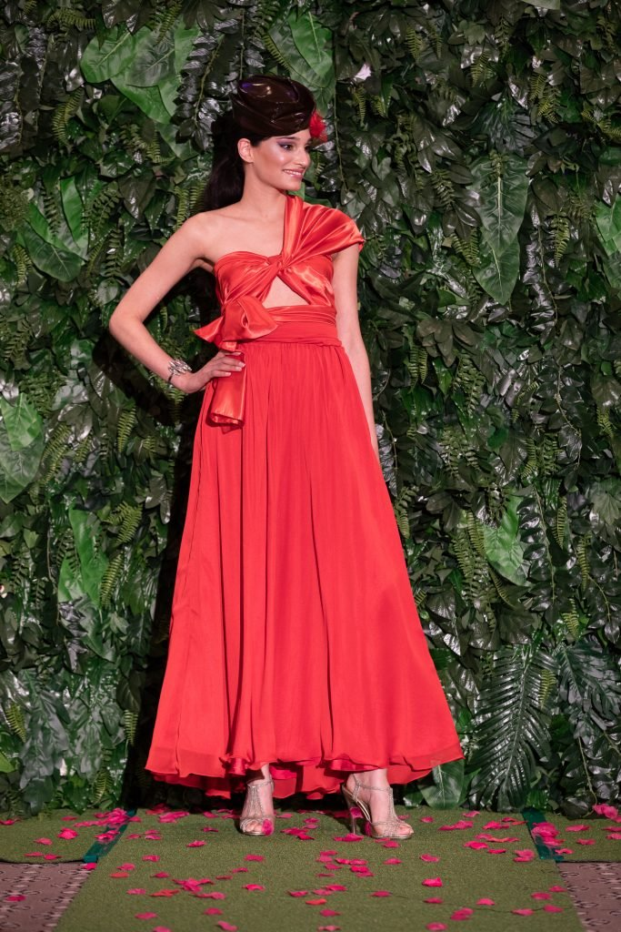 Lucy Laurita Wrap Top and Alida Skirt in red at the runway